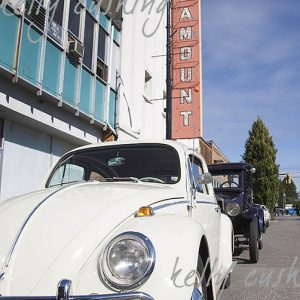 White Volkswagen Bug by Paramount Theatre