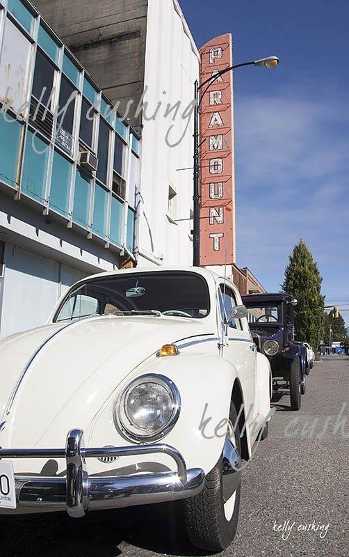 White Volkswagen Bug by Paramount Theatre